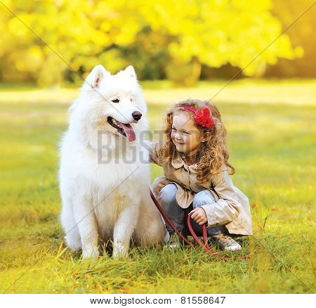 Positive Child And Dog Having Fun Outdoors In The Park