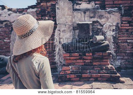 Woman Exploring Ancient Ruins