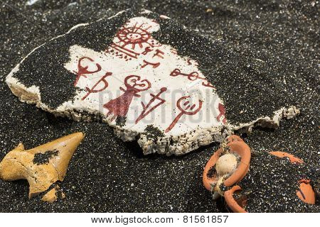 Stone With Petroglyphs On The Sand