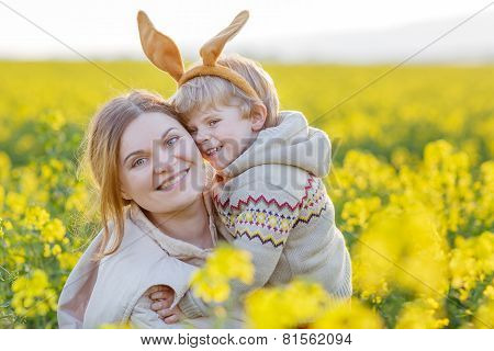 Little Toddler Child And His Mother In Easter Bunny Ears Having Fun