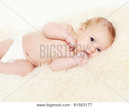 Infant Lying On The Bed At Home