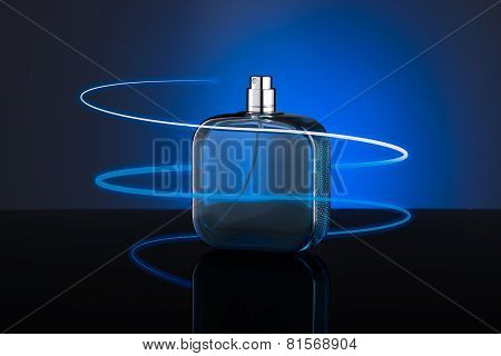 Blue Bottle Of Perfume Isolated On Blue Background