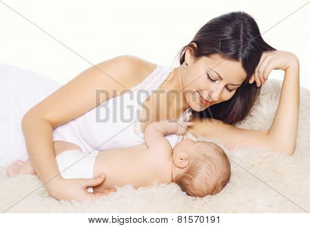 Happy Smiling Mother And Baby Lying On The Bed At Home, Family Comfort