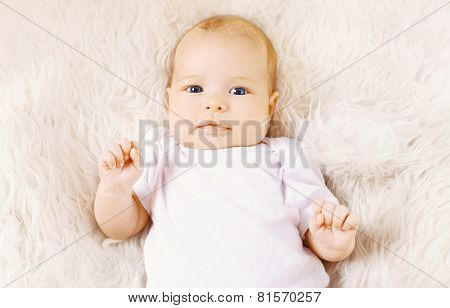 Sweet Infant Lying On The Bed, Top View
