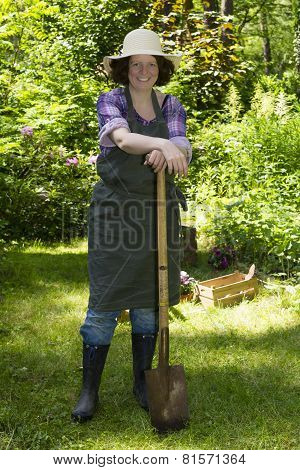 Woman With Spade In A Garden