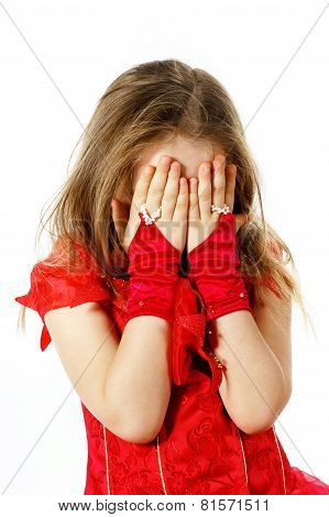 Cute Little Girl Dressed In Red Posing In Studio