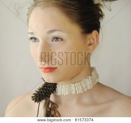 portrait photo of wondering fashion model girl with bush on her head