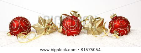 Christmas decoration from red baubles and gold stars