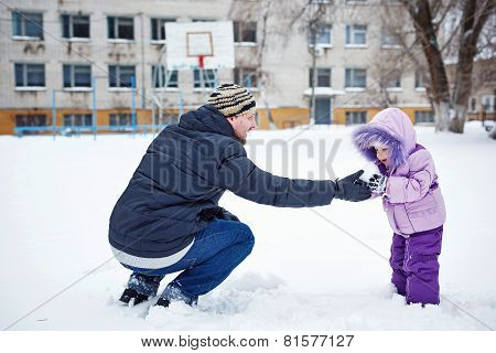 Father and daughter in winter park