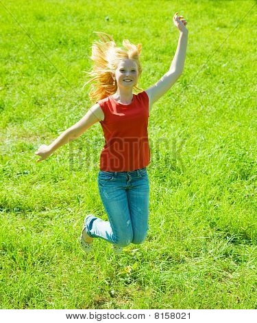 Jumping Red-haired Teen Girl