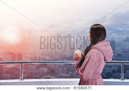 Woman on the balcony enjoying city view