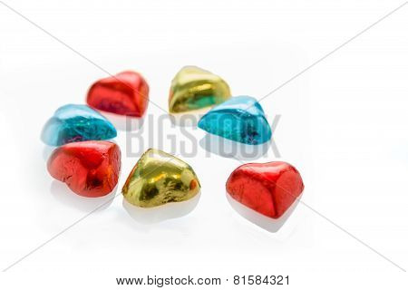 Colorful Chocolate Hearts On Isolated White Background