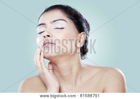 Woman Touching Her Face After Treatment