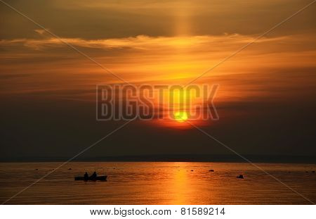 Fisherman Boat At The Sunset At The Ocean