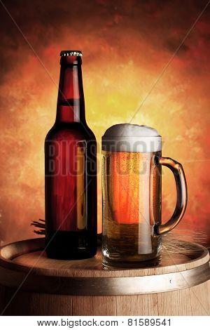 Mug And Bottle Of Beer On A Wooden Barrel