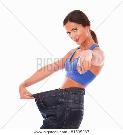 Fit Lady Happily Pulling Jeans On Waist