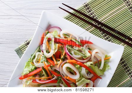 Salad With Vegetables And Squid Horizontal Top View Closeup