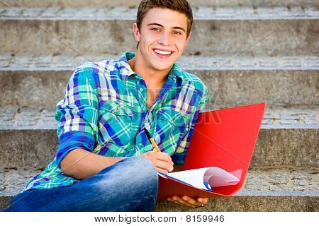 Student sitting on stairs