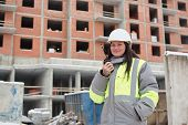 foto of inspection  - Civil Engineer at at construction site is inspecting ongoing production - JPG