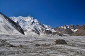 foto of shan  - Picturesque landscape on glacier below highest peaks in Tien - JPG