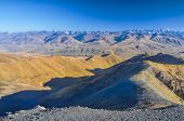 picture of arid  - Scenic arid mountainous landscape in Kyrgyzstan - JPG