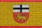stock photo of bonnes  - flag of Bonn painted on brick wall - JPG