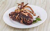 foto of cuttlefish  - Grilled cuttlefish with spices in the bowl - JPG