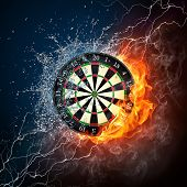 stock photo of infernos  - Darts Board in Fire and Water Isolated on Black Background - JPG