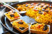 pic of local shop  - fresh paella prepared on mediterranean street market in Provence France - JPG