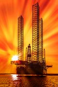 pic of oil drilling rig  - Oil drilling rig in sunset time at sea - JPG