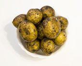 stock photo of crude  - The crude tubers of potatoes in a white dish - JPG