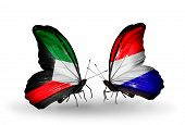 image of holland flag  - Two butterflies with flags on wings as symbol of relations Kuwait and Holland - JPG