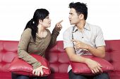 picture of conflict couple  - Portrait of young couple quarreling and blaming each other isolated on white - JPG