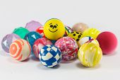 image of bouncing  - group of colorful bouncing rubber balls over white background