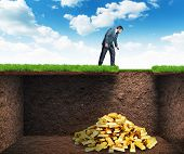 picture of rich soil  - Businessman found treasure in the soil - JPG