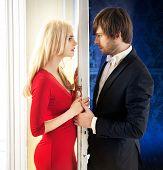 picture of girl next door  - Attractive couple standing next to a white door - JPG