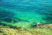 pic of crystal clear  - Young Man Floating in Crystal Clear Sea - JPG