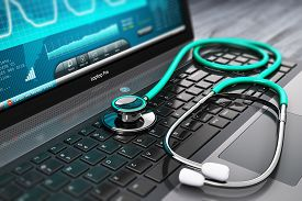 picture of stethoscope  - Laptop or notebook computer PC with medical cardiologic diagnostic test software on screen and stethoscope on black wooden business office table with selective focus effect - JPG