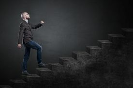 stock photo of stairway  - Concept or conceptual 3D male businessman on stair or steps near a wall background metaphor to success climb business rise achievement growth job career leadership education goal or future - JPG