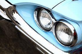 pic of muscle-car  - Color detail on the headlight of a vintage car - JPG