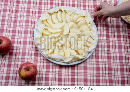 Arranging The Apples On The Pastry In The Mold
