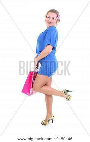 Sexy Woman In Blue Dress With Shopping Bag