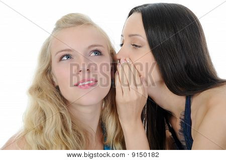 Two Beautiful Women Telling Secret