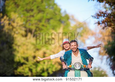 Happy people on a scooter