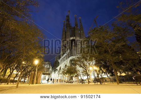BARCELONA, SPAIN - MAY 3, 2015: The Basilica of La Sagrada Familia at night. Designed by Antoni Gaudi, its construction began in 1882 and is not finished yet on May