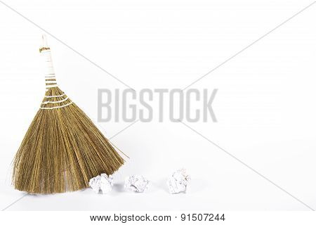 isolated household broom and paper trash