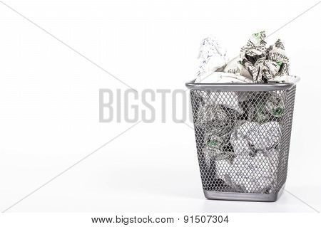 isolated wastebasket full of newspaper waste paper