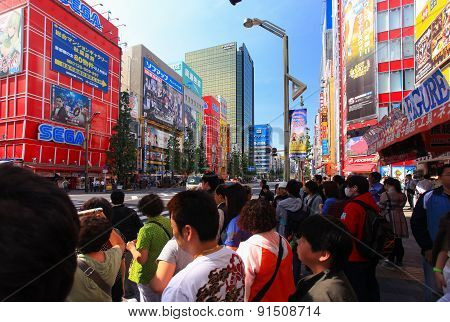 People crossing the street at Tokyo's Akihabara area