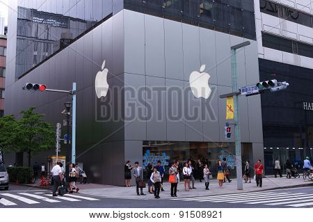 People on Main street of High end Ginza district of Tokyo with the official Apple store.