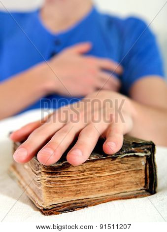 Person With The Old Book